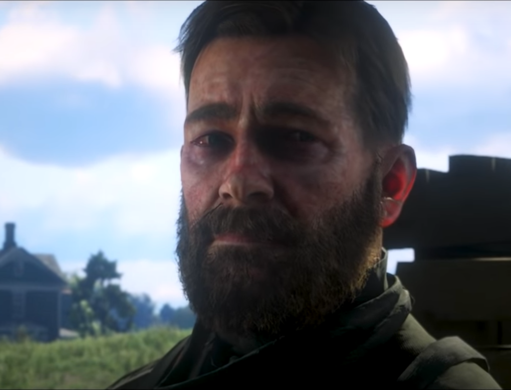 A bearded man stares slightly right of camera, looking ill, afraid, and tired.