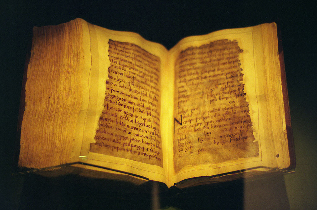 An ancient book, its pages much worn by time.