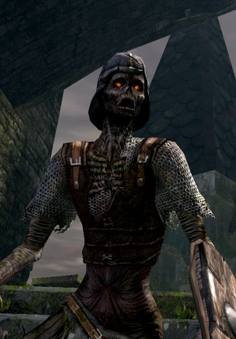 A zombie with glowing red eyes, wearing the tattered remains of a medieval soldier's armor, stands amid stone ruins.